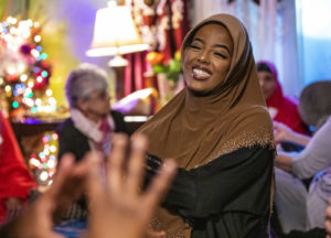Fosia Omar, 20, enjoys a conversation with friends while waiting for the sun to set to break the fast for the day on May 25, 2018. The Waite Park resident is a student at St. Cloud State University and is planning on majoring in psychology.
